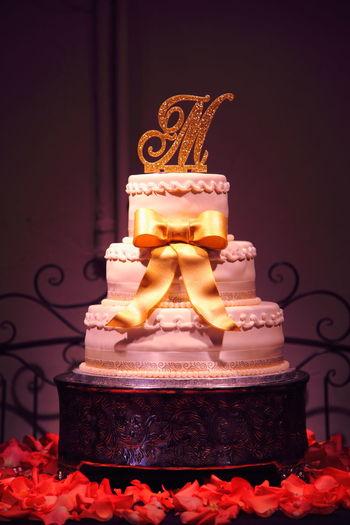 Wedding cake against wall