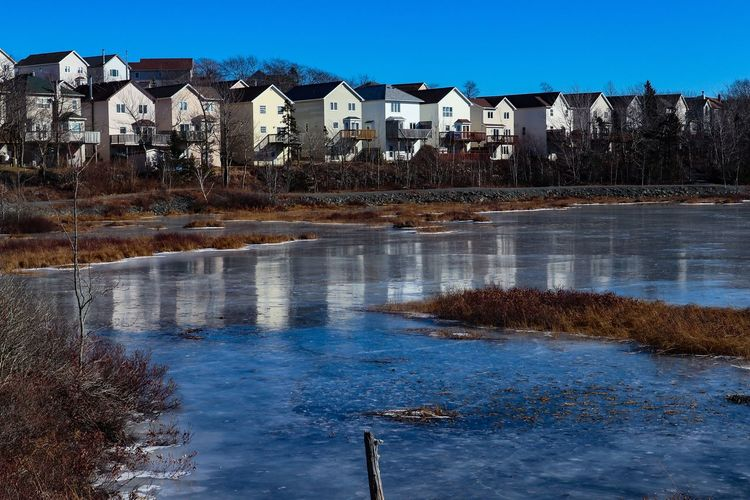 Icy Waters Ice Cold Temperature Mirrorless Halifax, Canada Cold Days Scenic View Serene Sunny Day Winter Frozen Frozen Marsh Water City Clear Sky Sky Architecture Building Exterior Waterfront Settlement Lake Calm Standing Water Residential Structure Shore