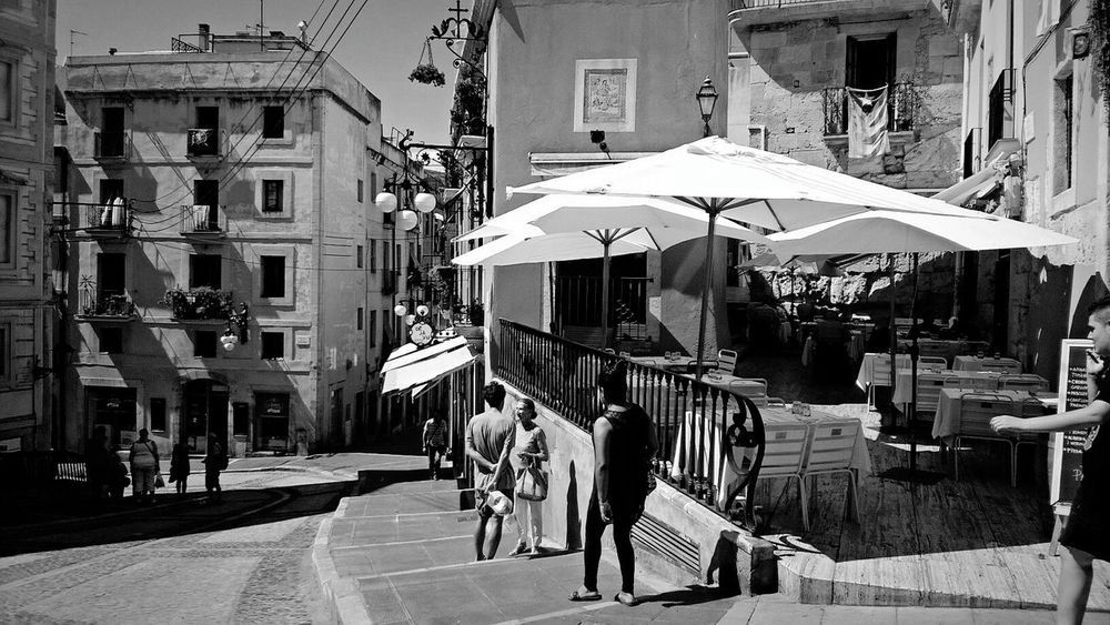 Architecture Building Exterior Outdoors Large Group Of People Real People Day People Women Men Adult Adults Only City Old Town Streetphotography Street Cafeteria Umbrellas Old Architecture Black & White Summer Sumertime