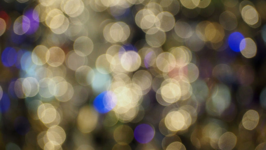 Colorful blurred bokeh lights in the night time. Abstract Background Blurred Bokeh Bokeh; Blurred; Background; Blur; Abstract; Texture; Night; City; Light; Color; Dark; Lights; Black; Party; Design; Colorful; Decoration; Circle; Bright; Shiny; Street; Defocused; Table; Effect; Christmas; Out Focus; Blue; Yellow; Red; Shine; Art; Pattern Defocused Illuminated Light Night Out Focus