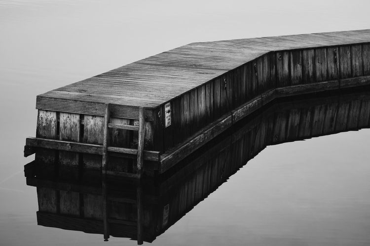 Peaceful Lake Water Wood - Material No People Nature Day Outdoors Built Structure Bridge Footbridge Lake Wood Leisure Activity Calm Calmness Peace Peaceful Peace And Quiet Tegernsee Vacations Soul Soul Searching Minimalism Minimal Nature EyeEm Best Shots