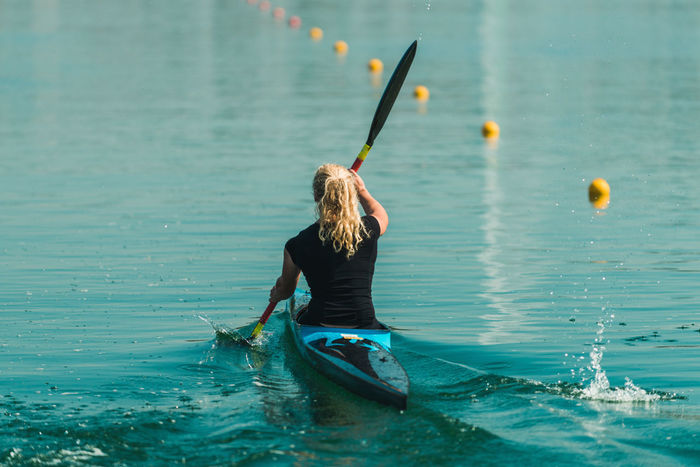 Athlete Cool Females From Behind Girl Power Kayaking Rowing Water Sport Woman Black Blue Female Female Athlete Girl Kayak Kayaker Kayakingadventures Lake Real People Sport Sport Rowing Unrecognizable Person Water Water Sports