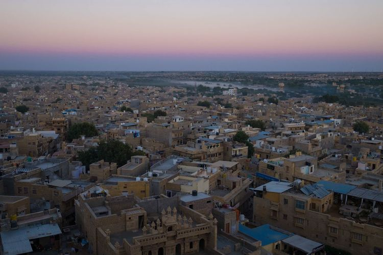 Sunset in Jaisalmer Jaisalmer Rajasthan India Architecture Building Exterior Crowded Cityscape Sky Built Structure High Angle View Sunset Outdoors City Travel Destinations