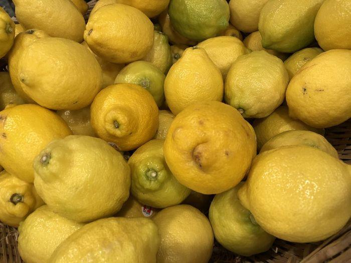 Full Frame Shot Of Lemons For Sale At Market Stall