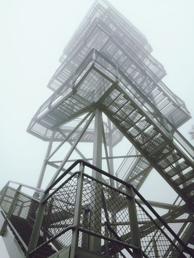 No matter how much we build or how high we build nature will always be there. Architecture Low Angle View No People Sky Outdoors Day Steel Fog Foggy Towers