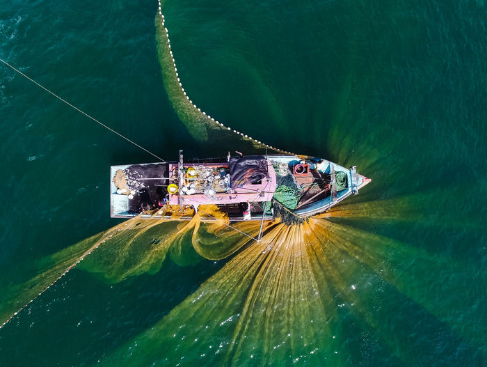 Fishing net is spread out Malaysia Drone  Stunning Amazing View Boat Fisherman Ocean Moments Fisherman Boat Net Fishing Fishing Boat Fishing Net Amazing Water Nautical Vessel Sea RISK High Angle View The Great Outdoors - 2018 EyeEm Awards EyeEmNewHere