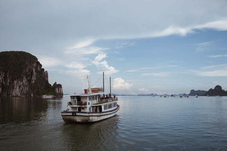 Halong Bay Vietnam Vietnam Adventure Beauty In Nature Boat Cloud - Sky Day Explore Mode Of Transport Moored Mountain Nature Nautical Vessel No People Outdoors Scenics Sea Sky Tranquility Transportation Water Waterfront