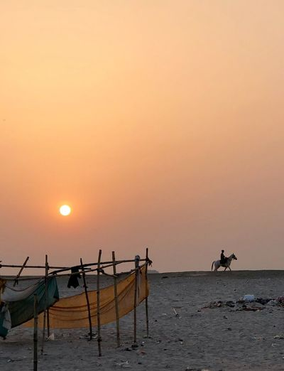 Ganga India Sky Sunset Sea Water Orange Color Beauty In Nature Scenics - Nature Tranquility Idyllic Clear Sky Sun Tranquil Scene Horizon Copy Space Horizon Over Water Land Beach Incidental People Outdoors Nature