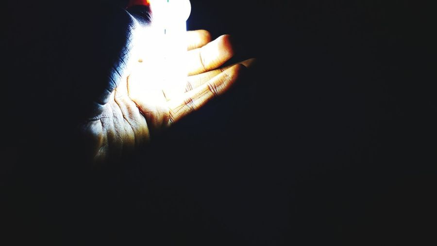 EyeEm Selects smartphonephotography darkness EyeEm Selects Smartphonephotography Dim Light WeekOnEyeEm Human Hand Black Background Studio Shot Human Finger Close-up Darkroom Lit Tea Light Light Bulb This Is Family This Is My Skin