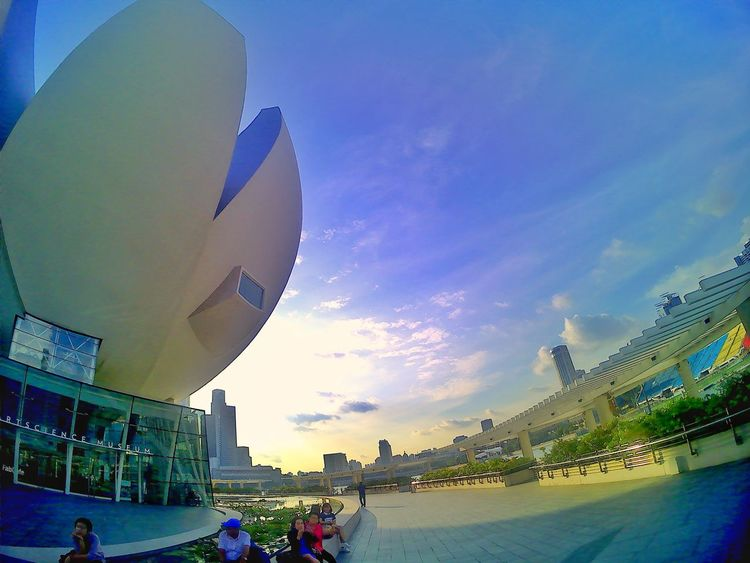 Sky Outdoors Urban Skyline Cityscape Day Architecture Scenery Landscape Singapore Blue Travel Travelphotography Buildings & Sky Travel Photography Wide Shot Wide Open Spaces Travel Destinations Bpro5alpha Illuminated Wideangle ArtScience Museum Low Angle View Sunny Day Building Exterior Colors