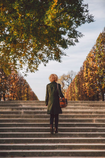 Autumn Autumn Colors 43 Golden Moments Casual Clothing Climbing Stairs Full Length Girl Growth Leisure Activity Lifestyles Nature Outdoors Park Rear View Sky Stairs Stairs Standing The Way Forward Tranquility Tree Feel The Journey Tuileries Garden Original Experiences People And Places Your Ticket To Europe Connected By Travel The Fashion Photographer - 2018 EyeEm Awards Urban Fashion Jungle #urbanana: The Urban Playground Autumn Mood