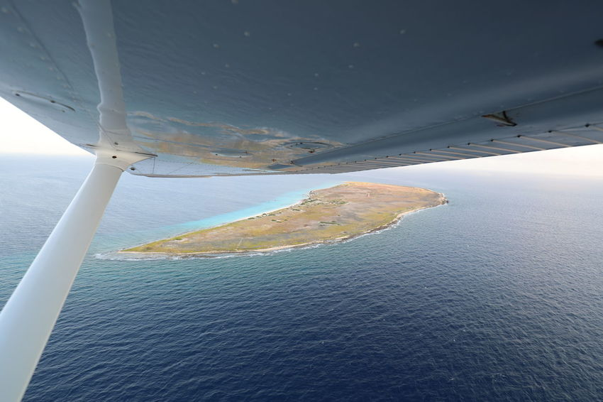 Aerial View Air Vehicle Aircraft Wing Airplane Caribbean Sea Day Flying Island In The Sun Klein Curacao Motion Nature No People Outdoors Sky Transportation