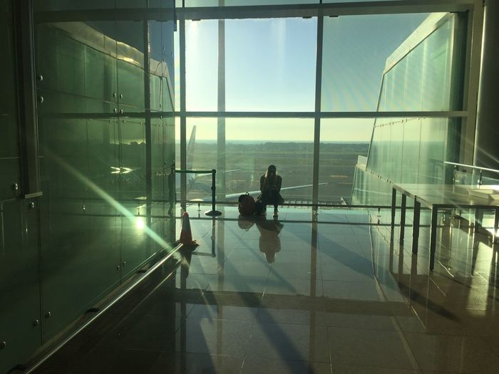 Travel Light Real People Glass - Material Transportation Window Reflection Nature Lifestyles Travel Airport Sunlight Built Structure Architecture