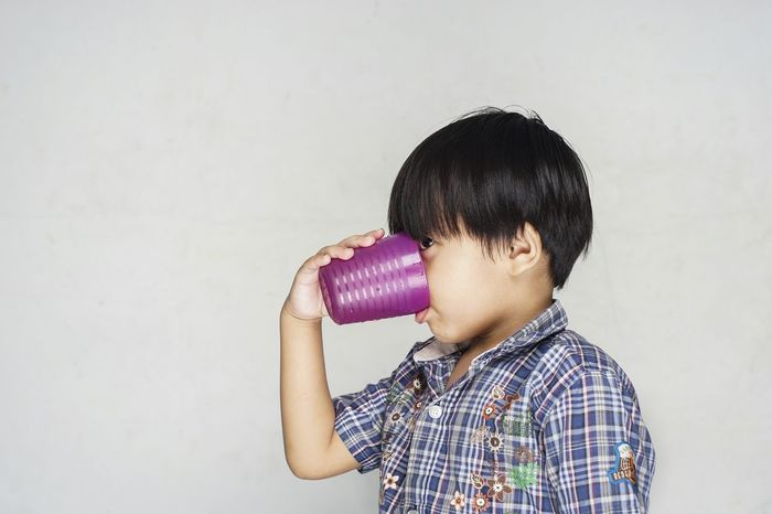 Drinking plain water is good for the body Child Studio Shot One Person Spotted Headshot White Background Children Only People Childhood Human Body Part Gray Background Close-up Adult Day Drink Drinking Healthy Healtydrinks