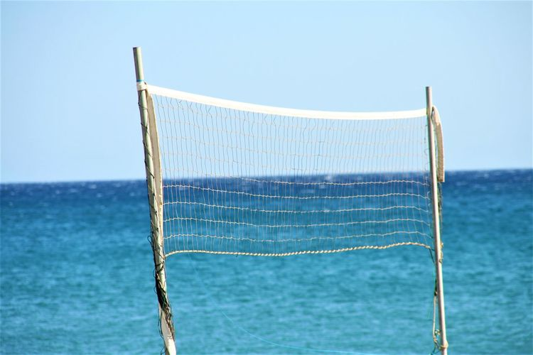 View of net in sea against clear sky