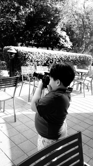 Photography knows no age Blackandwhite Photography Visualstorytelling Visualstoryteller Children Boys Portrait Photography Youngphotographer Startemyoung