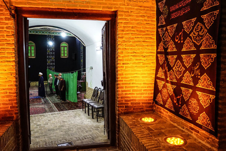 Travel Destinations Travel Photography Iran Shia Community Nomadic Zoroastrian Islamic Architecture Architecture Illuminated Built Structure Building Indoors  Lighting Equipment Door Entrance Business Restaurant Night Seat Window Wall Glass - Material Transparent Open Absence