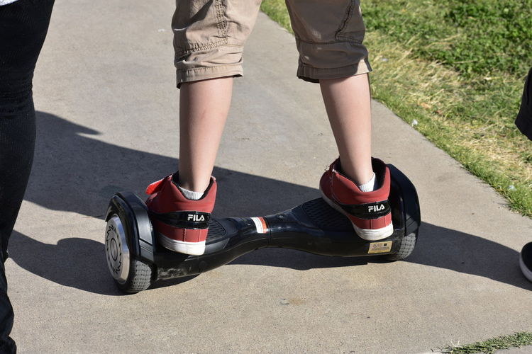 Out Of The Box Hover Board Young Adult Legs And Feet Leisure Activity Sneakers Of EyeEm Low Section Human Leg Human Body Part Outdoors EyeEm EyeEm Gallery Eyeem Market Sneakers Grass Casual Clothing Playing Outside Hoverboard Sidewalk Let's Go. Together. 100 Days Of Summer Sommergefühle