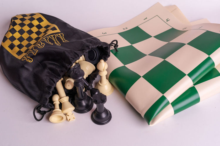 Chess set on white background. Indoors  Chess Game Competition Queen King - Royal Person King Army Strategy Leader Leadership Decisions Still Life Relaxation Studio Shot No People Close-up Representation Lying Down Sport Board Game Two Objects Mammal High Angle View Sleeping Black Color Casual Clothing Domestic Animals