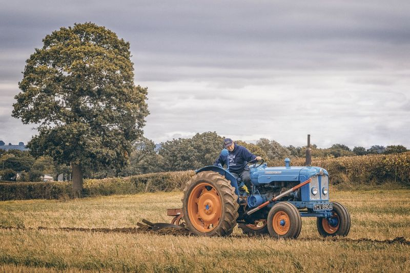 Ploughing EyeEm Selects Agricultural Machinery Agriculture Landscape Plant Field Mode Of Transportation Sky Transportation Farm Land Vehicle Tractor Rural Scene Land Nature Machinery Tree Agricultural Equipment Growth Day Cloud - Sky