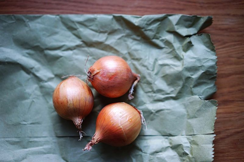 High angle view of onions on paper bag
