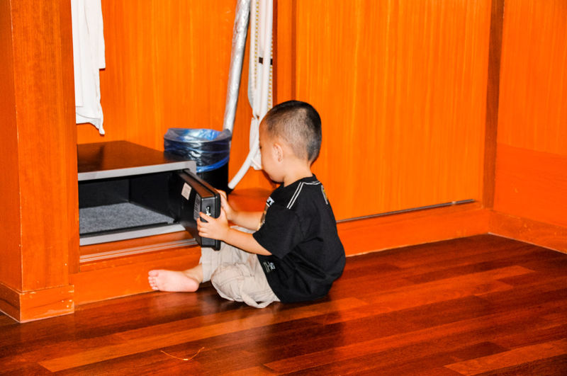 Boy opening drawer at home