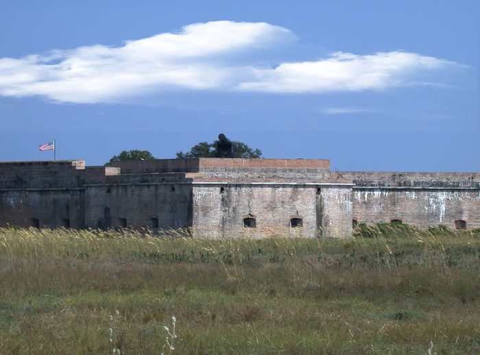 View of the Tower Bastion from outside Fort Barrancas Ancient Architecture Building Exterior Built Structure Castle Cloud Cloud - Sky Cloudy Day Deterioration Exterior Fort Pickens Grass Historic History No People Old Outdoors Run-down Sky The Past Travel Destinations