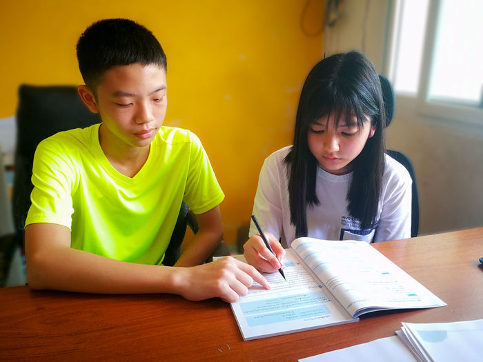 Boy and girl studying at table
