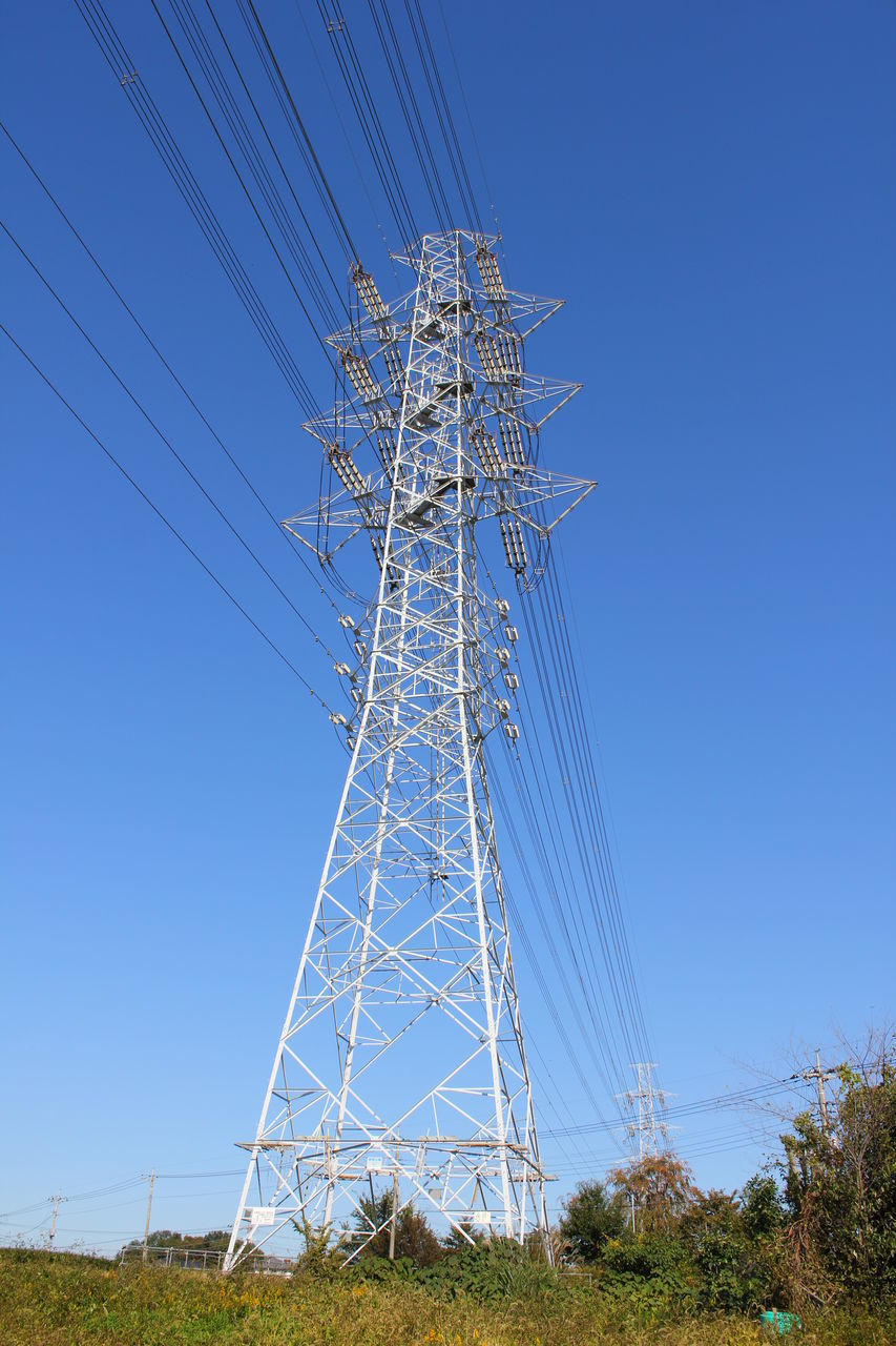 sky, fuel and power generation, electricity, blue, low angle view, clear sky, technology, connection, power supply, electricity pylon, nature, power line, cable, plant, field, land, day, tree, no people, tall - high, outdoors, electrical equipment