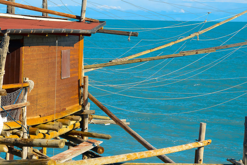 Beauty In Nature Blue Cable Day Mode Of Transport Nature Nautical Vessel No People Outdoors Scenics Sea Sky Trabocchi Coast Trabocco Transportation Water Wood - Material