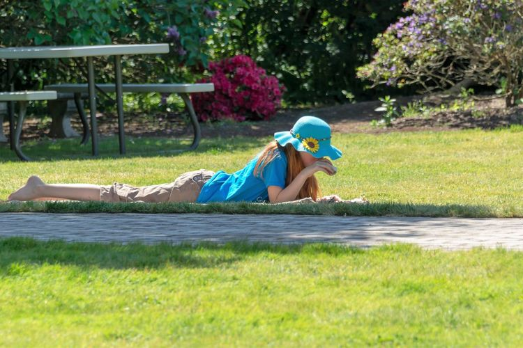 Child Childhood Grass Plant One Person Full Length Leisure Activity Day Nature Real People Lifestyles Relaxation Lying Down Casual Clothing Field Males  Boys Land Outdoors