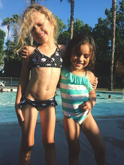 Natural Light Portrait My Amazing and Adventurous Daughters Hanging Out at the Local Wading Pool- Happy as Two Peas in a Poolside Pod Hanging Out Summer Girls Sisters Poolside Play Water Swim Splash Smile Enjoying Life Children Siblings Fun Sunny Day Happy Cheese! Lakewood California Showcase June Moments Sweet Lifestyles Childhood