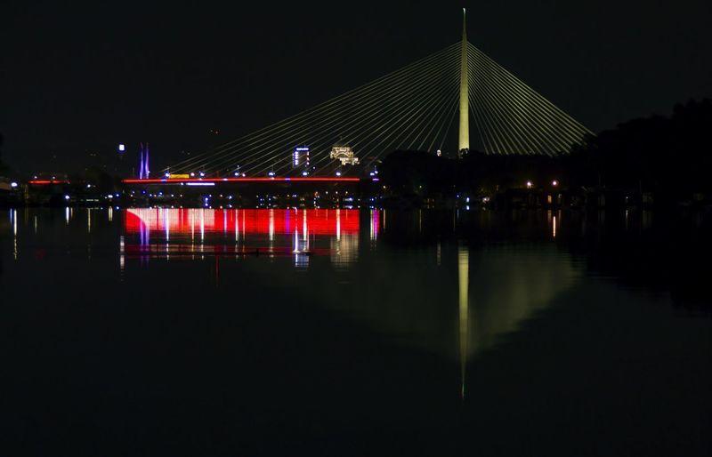 Ada Bridge is based on more than 200 meters high pylon, with beautiful illumination Bridge Traffic Illuminated City Street River Reflections Night Pylon