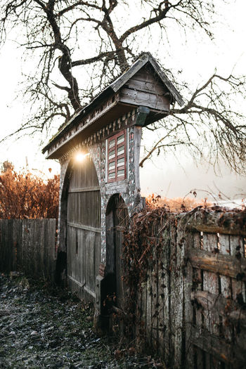 Sekler gate at Transylvania. Romania. 2018 #pelephotography Orange Color Orange Pele Photography Hikingadventures Transylvania Nature Photography Romanian  Cold Temperature Sunrise_sunsets_aroundworld Sunrise Rural Scene Cold Morning Sushine Gate Beautiful Culture Cultures European  Transylvanian Tree Water Sky Farmland Frozen Weather Condition Frost Covering Winter