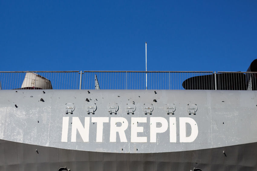 Military Vessel USS Intrepid Museum New York Text Communication Sky Low Angle View Architecture Blue Western Script Clear Sky Built Structure Nature Sign Day Copy Space No People Capital Letter Information Metal Building Exterior Outdoors Non-western Script