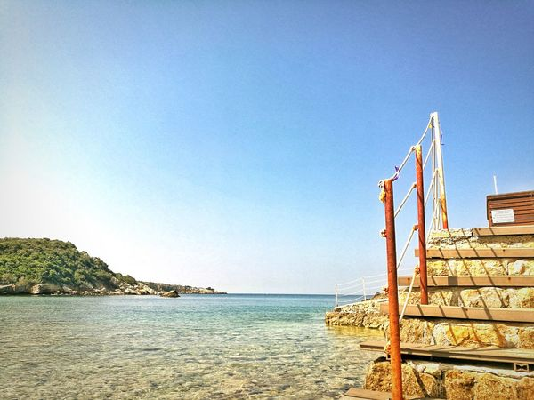Sea Beach Water Blue No People Outdoors Day Sand Clear Sky Sky Nature Horizon Over Water Beauty In Nature Tree The Great Outdoors - 2017 EyeEm Awards Live For The Story
