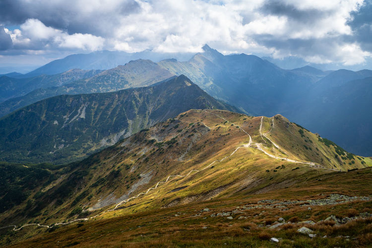 Sunbath Mountain Beauty In Nature Mountain Range Cloud - Sky Scenics - Nature Landscape Sky Nature Day Majestic Physical Geography Mountain Ridge No People