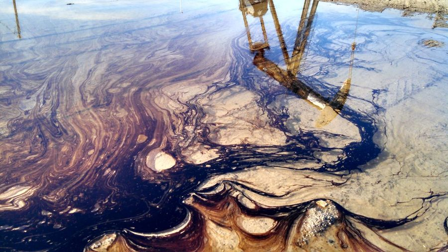 High Angle View Of Oil Spill On Water