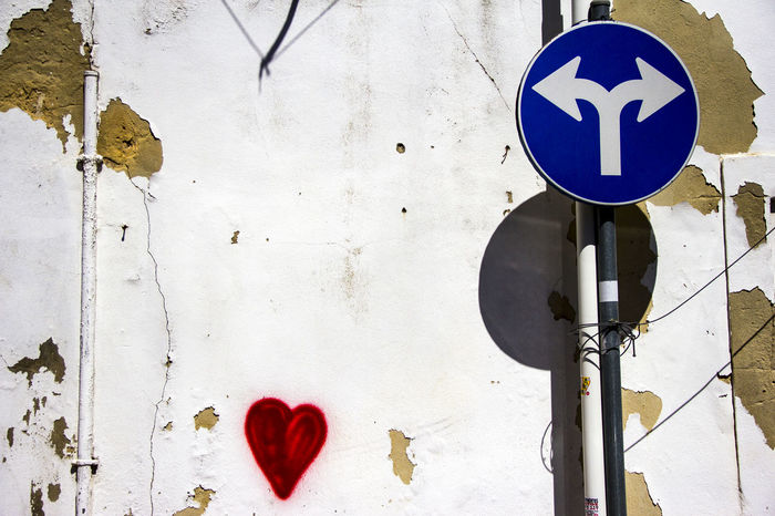 A sign and a heart Alone Art Blue Sign Day Earth Graffiti Loneliness Love Nature No People Obligatory Outdoors Peace Photography Portugal Quiet Red Heart Road Sign Sign Silence Simplicity Two Way Two Ways To Go