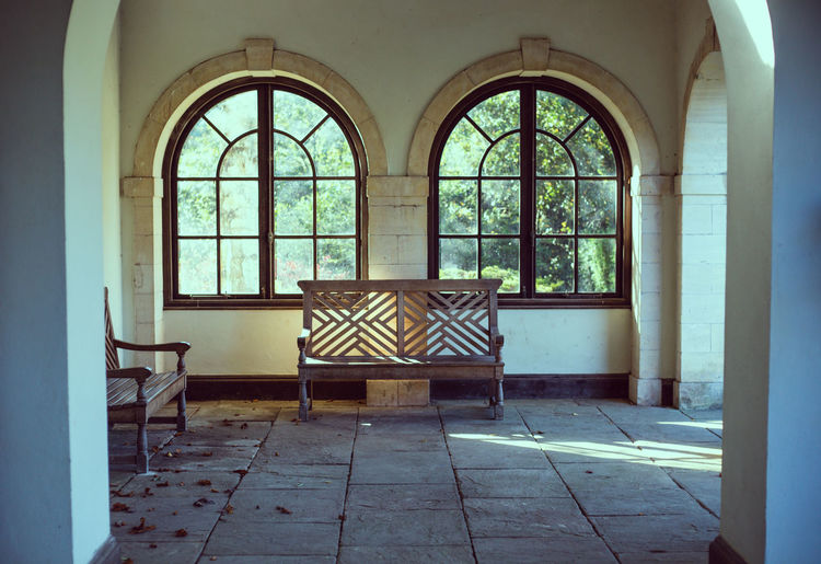 Bodnant gardens in North Wales UK Window Seat Chair Flooring Indoors  Day Glass - Material No People Empty Architecture Absence Table Arch Transparent Wood - Material Built Structure Furniture Building Nature Tiled Floor Bench In Front Of Window Rustic Filter