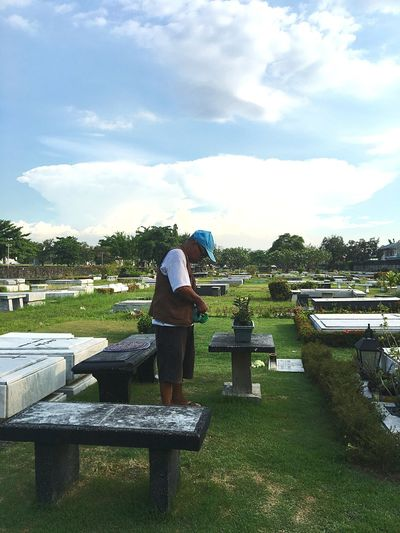 The Visit Cemetery Sky Cloud - Sky Real People Water Nature Full Length Day Men Two People People Adult Lifestyles Leisure Activity Standing Togetherness Women Rear View Sunlight Plant Outdoors