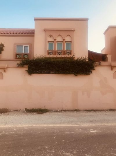 Peach Architecture Built Structure Building Exterior Building Window No People Nature Sunlight Low Angle View Plant City Wall - Building Feature Outdoors Clear Sky Residential District Sky House Day Wall Water