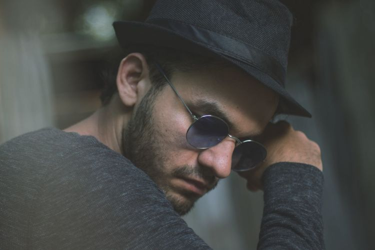 Side view of man wearing sunglasses