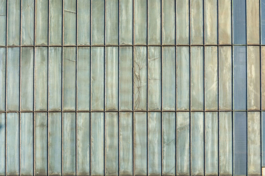 Silver-colored metal wall corrugated sheet metal background. Pattern Pieces Background Backgrounds Close-up Corrugated Iron Day Full Frame Garage Sale Gray Metal No People Outdoors Pattern Surface Textured