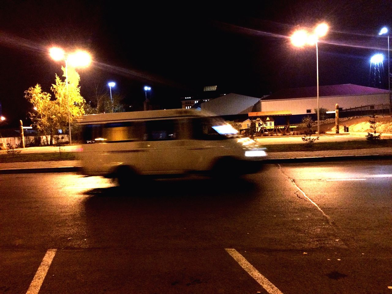 night, illuminated, blurred motion, transportation, lighting equipment, road, speed, land vehicle, street, mode of transport, street light, motion, outdoors, no people, city, sky