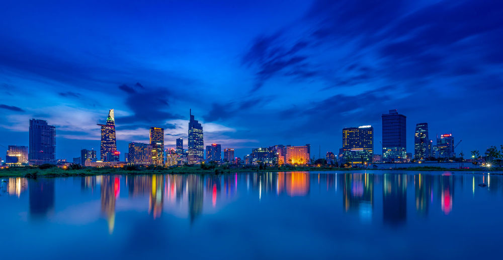 The reflection of Saigon city in blue hour. Architecture Sky Reflection City Building Exterior Built Structure Illuminated Building Night Water Urban Skyline Cityscape Landscape Cloud - Sky Blue Dusk Skyscraper Office Building Exterior Nature No People Outdoors Purple Nightlife