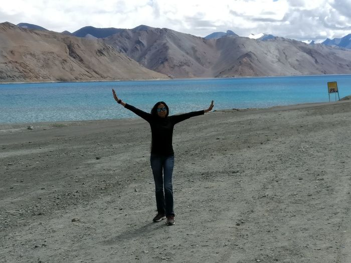 Fly Day Nature Adventure Mountain Beach One Woman Only Landscape Real People Vacations Sky Sunlight Silence Communication Lake pangong