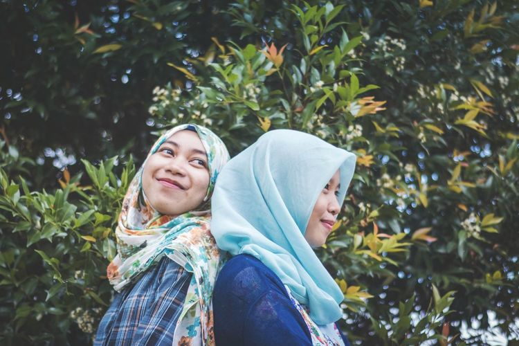 Fashion Stories Portrait Of A Woman Portrait Photography portrait of a friend Indonesia Photography  INDONESIA EyeEmNewHere Smiling Two People Togetherness Adults Only Happiness Portrait Only Women Adult People Day Outdoors Women Rural Scene Looking At Camera Mature Adult Casual Clothing Young Women Fruit Bonding Tree