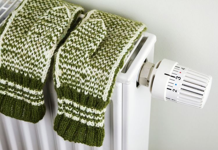 High angle view of gloves on radiator at home