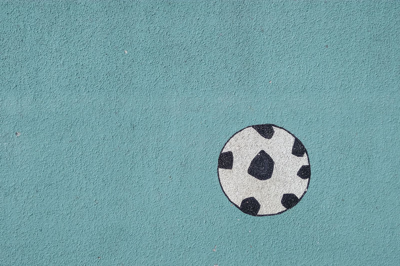 Soccer Ball Painting On Blue Wall